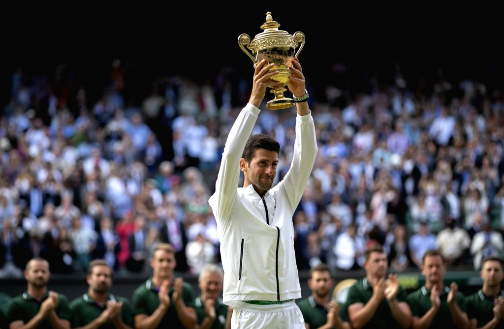 LONDON, July 15, 2019 (Xinhua) -- Novak Djokovic of Serbia holds the trophy after winning the men's singles final against Roger Federer of Switzerland at the 2019 Wimbledon Tennis Championships in London, Britain, on July 14, 2019. Novak Djokovic won
