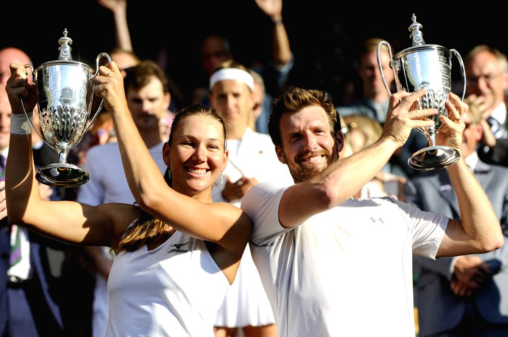 LONDON, July 16, 2018 - Alexander Peya (R) of Austria and Nicole Melichar of the United States show their trophies after winning the mixed doubles final match against Jamie Murray of Britain and ...