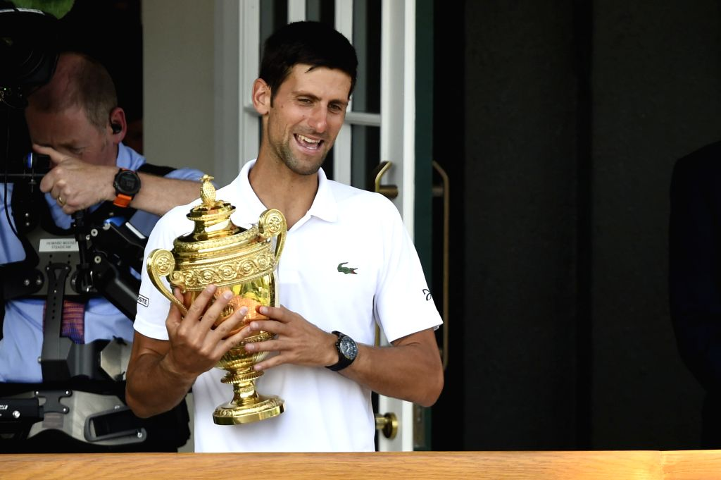 LONDON, July 16, 2018 - Novak Djokovic of Serbia shows his trophy after winning the men's singles final match against Kevin Anderson of South Africa at the Wimbledon Championships 2018 in London, ...