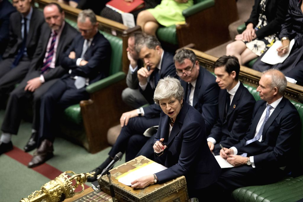 LONDON, July 17, 2019 - British Prime Minister Theresa May (front) attends the Prime Minister's Questions at the House of Commons in London, Britain, on July 17, 2019. (Jessica Taylor/UK ... - Theresa May