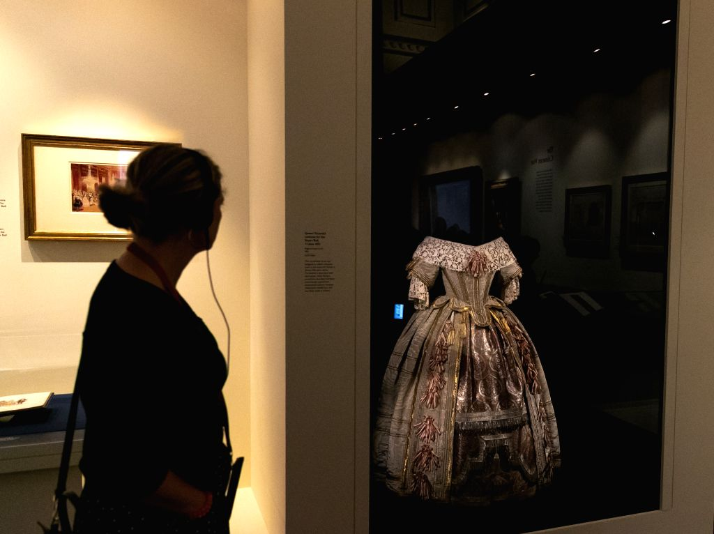 "LONDON, July 19, 2019 - A visitor views an exhibit during a media preview of the special exhibition ""Queen Victoria's Palace"" at Buckingham Palace in London, Britain, on July 19, 2019. To ..."