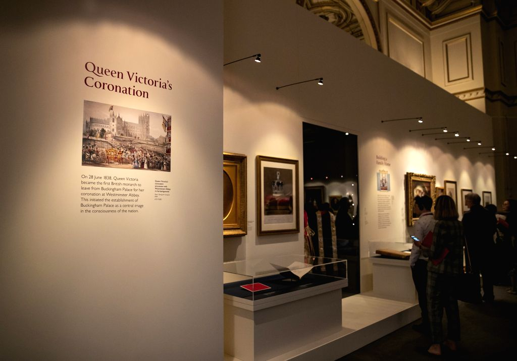 "LONDON, July 19, 2019 - People view exhibits during a media preview of the special exhibition ""Queen Victoria's Palace"" at Buckingham Palace in London, Britain, on July 19, 2019. To mark ..."