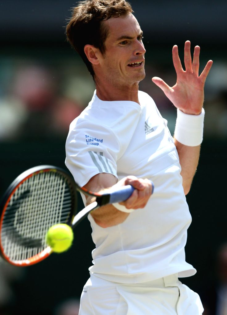 Britain's Andy Murray returns a shot during the men's singles quarter final against Bulgaria's Grigor Dimitrov at the 2014 Wimbledon Championships in Wimbledon, ...