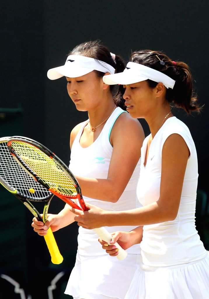 China's Peng Shuai and Chinese Taipei's Hsieh Su-wei(R) react during the women's doubles third round match against France's Mladennvic and Hungary's Babos at the 2014