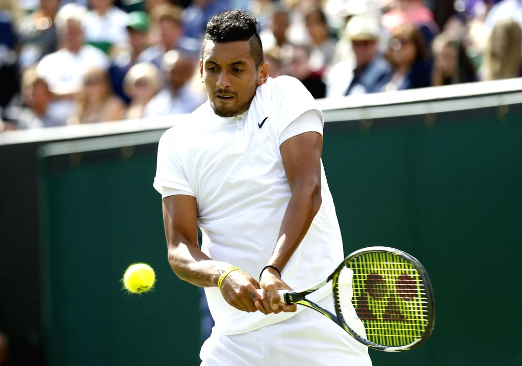 LONDON, July 2, 2016 - Nick Kyrgios of Australia hits a return to Dustin Brown of Germany during their men's singles second round match at the Wimbledon Tennis Championships in London, Britain, on ...