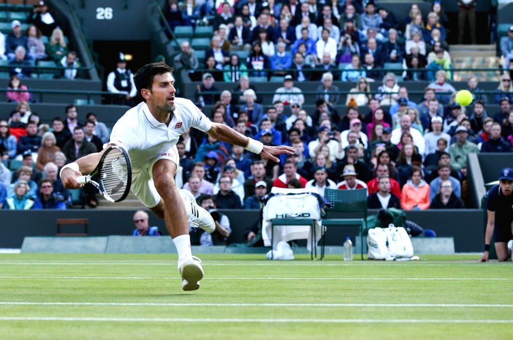 LONDON, July 2, 2016 - Novak Djokovic of Serbia hits a return to Sam Querrey of the United States during their men's singles third round match at the Wimbledon Tennis Championships in London, ...