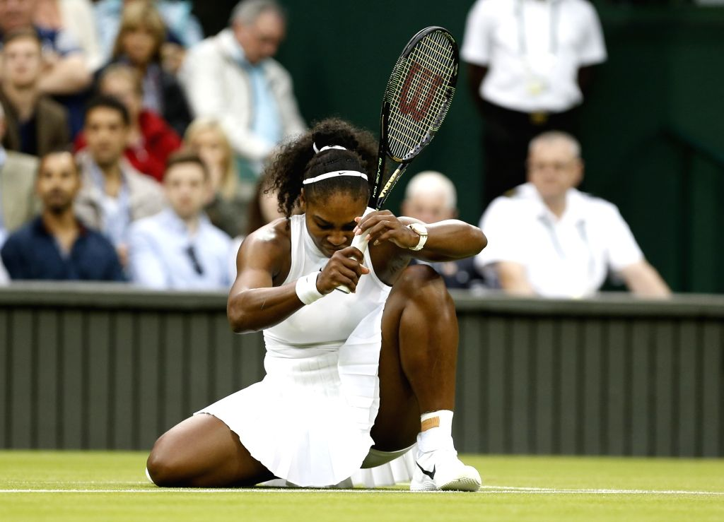 LONDON, July 2, 2016 - Serena Williams of the United States tumbles over during the women's singles second round match against her compatriot Christina McHale at the Wimbledon Tennis Championships in ...
