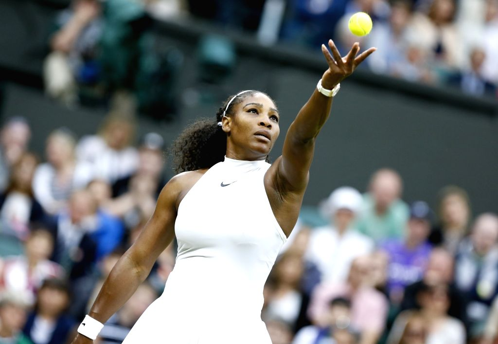 LONDON, July 2, 2016 - Serena Williams of the United States serves to her compatriot Christina McHale during their women's singles second round match at the Wimbledon Tennis Championships in London, ...