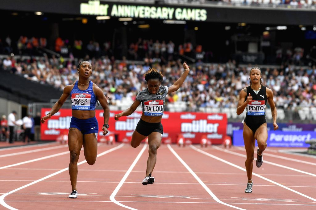 LONDON, July 22, 2019 - Shelly-Ann Fraser-Pryce of Jamaica (L) competes in the women's 100m final during Muller Anniversary Games at London Stadium in London, Britain, on July 21, 2019.
