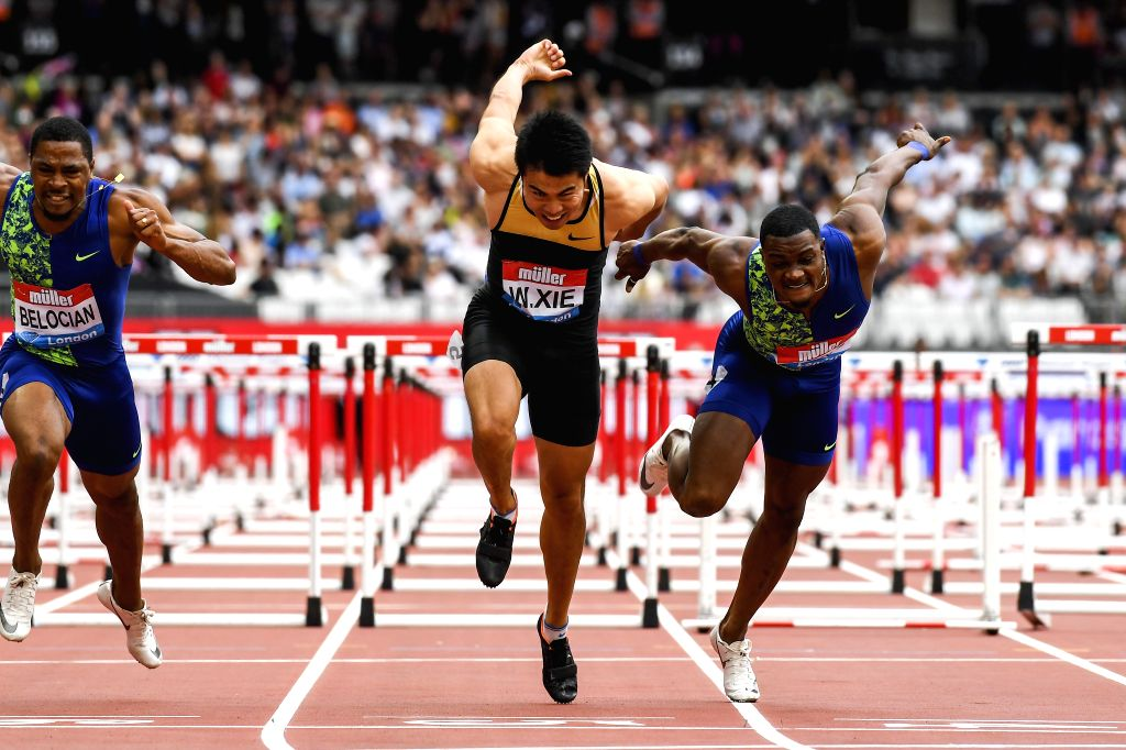 LONDON, July 22, 2019 - Xie Wenjun (C) of China competes during the men's 110m hurdles final at Muller Anniversary Games at London Stadium in London, Britain, on July 21, 2019.