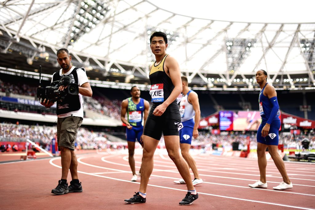 LONDON, July 22, 2019 - Xie Wenjun (C) of China celebrates after the men's 110m hurdles final at Muller Anniversary Games at London Stadium in London, Britain, on July 21, 2019.