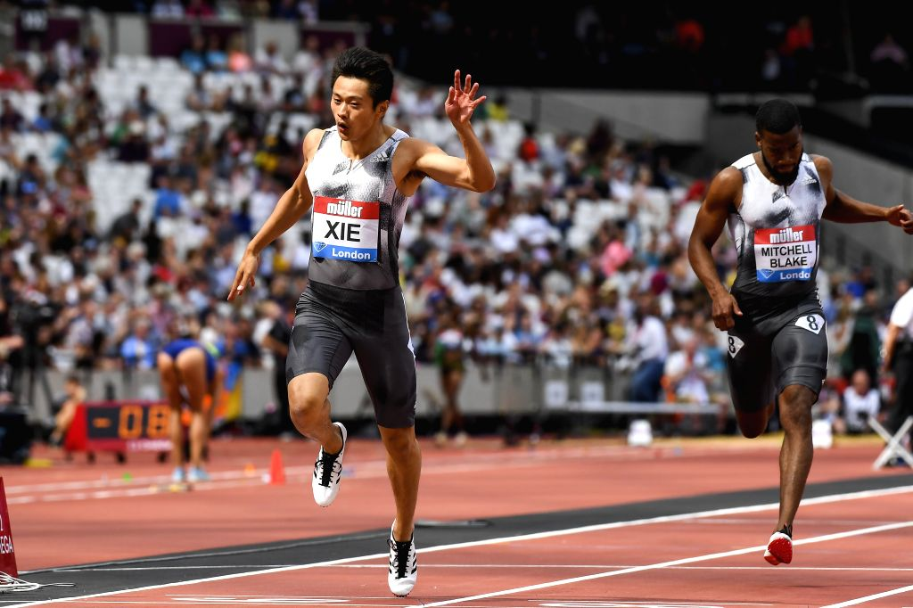 LONDON, July 22, 2019 - Xie Zhenye (L) of China competes during the men's 200m final at Muller Anniversary Games at London Stadium in London, Britain, on July 21, 2019.