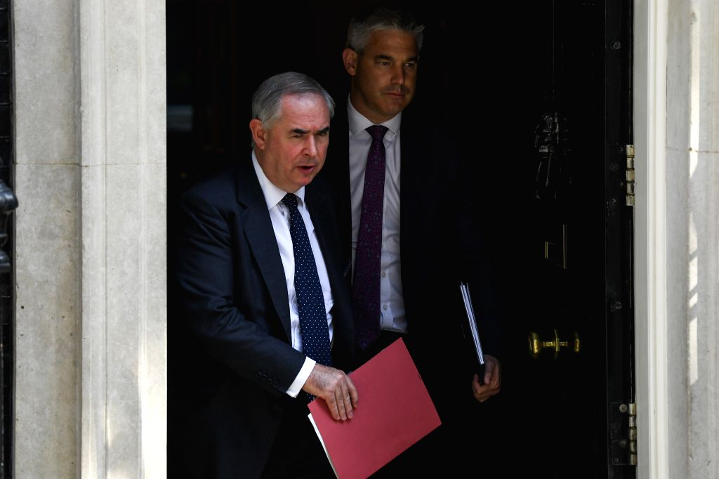 LONDON, July 25, 2019 - Britain's Attorney General Geoffrey Cox (L) and Brexit Secretary Stephen Barclay leave 10 Downing Street after attending a cabinet meeting in London, Britain, on July 25, 2019.