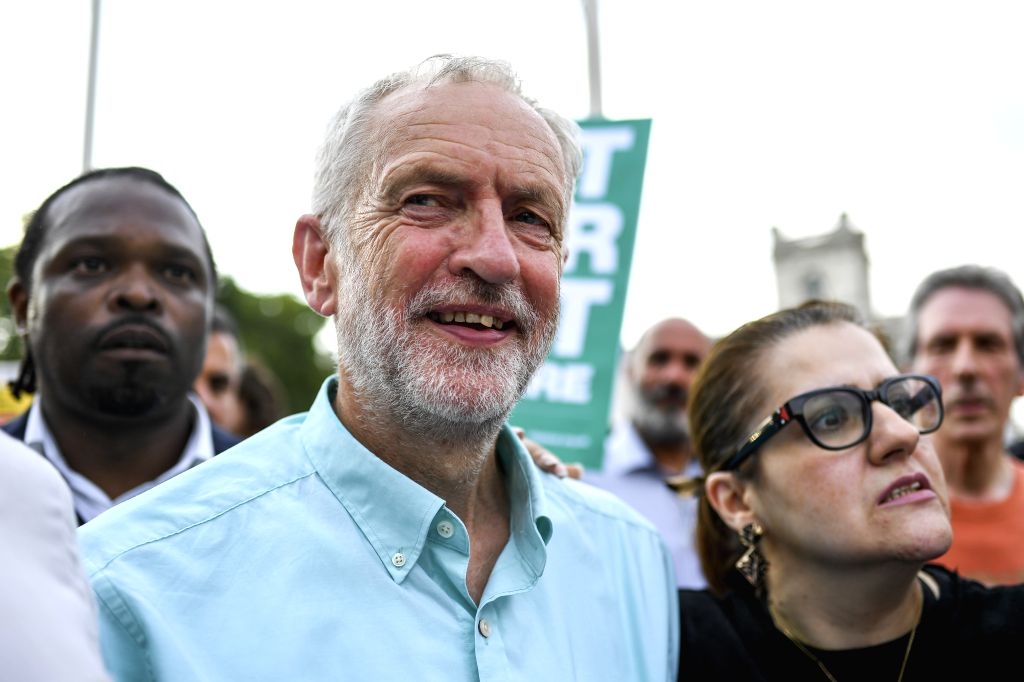 LONDON, July 25, 2019 - Britain's Labour Party leader Jeremy Corbyn (L, front) attends a rally at the Parliament Square, calling for a general election, in London, Britain, on July 25, 2019.