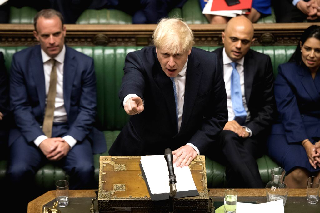 LONDON, July 25, 2019 - British Prime Minister Boris Johnson (front) makes his first statement in the House of Commons in London, Britain, on July 25, 2019. - Boris Johnson