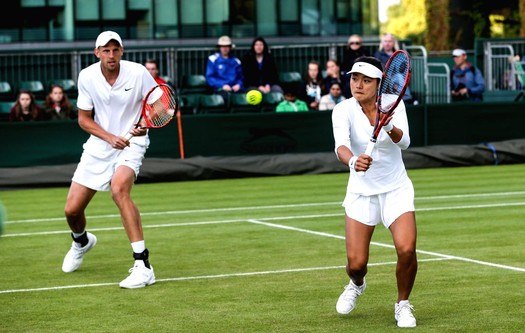 LONDON, July 3, 2016 - Andreas Siljestrom of Sweden and Wang Yafan (R) of China compete during the mixed doubles first round match against British partners Dominic Inglot and Laura Robson at the ...