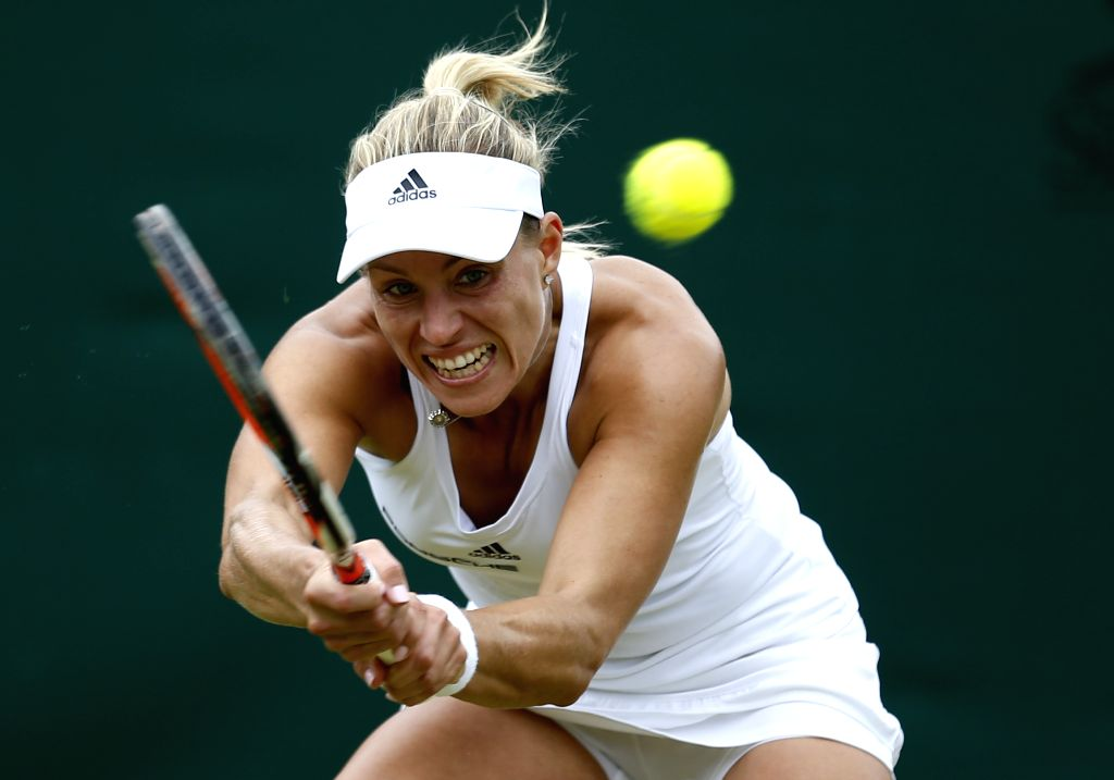 LONDON, July 3, 2016 - Angelique Kerber of Germany hits a return to her compatriot Carina Witthoeft during their women's singles third round match at the Wimbledon Tennis Championships in London, ...