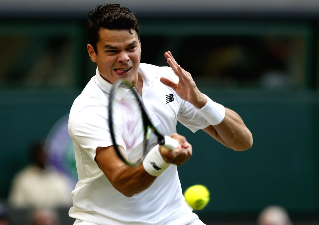LONDON, July 3, 2016 - Milos Raonic of Canada hits a return to Jack Sock of the United States during their men's singles third round match at the Wimbledon Tennis Championships in London, Britain, on ...