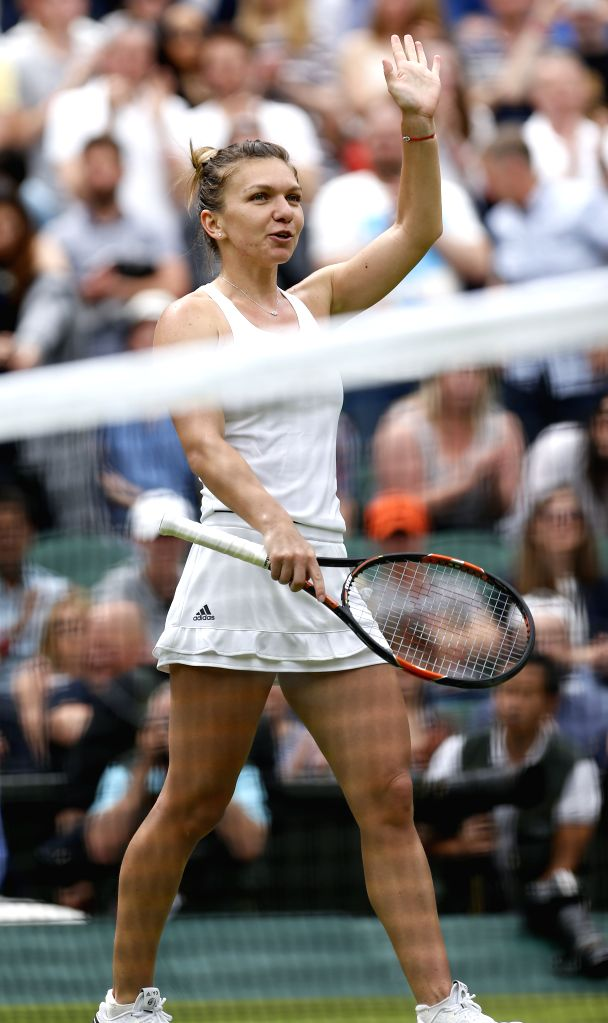 LONDON, July 3, 2016 - Simona Halep of Romania waves to the audience after the women's singles third round match with Kiki Bertens of the Netherlands at the Wimbledon Tennis Championships in London, ...
