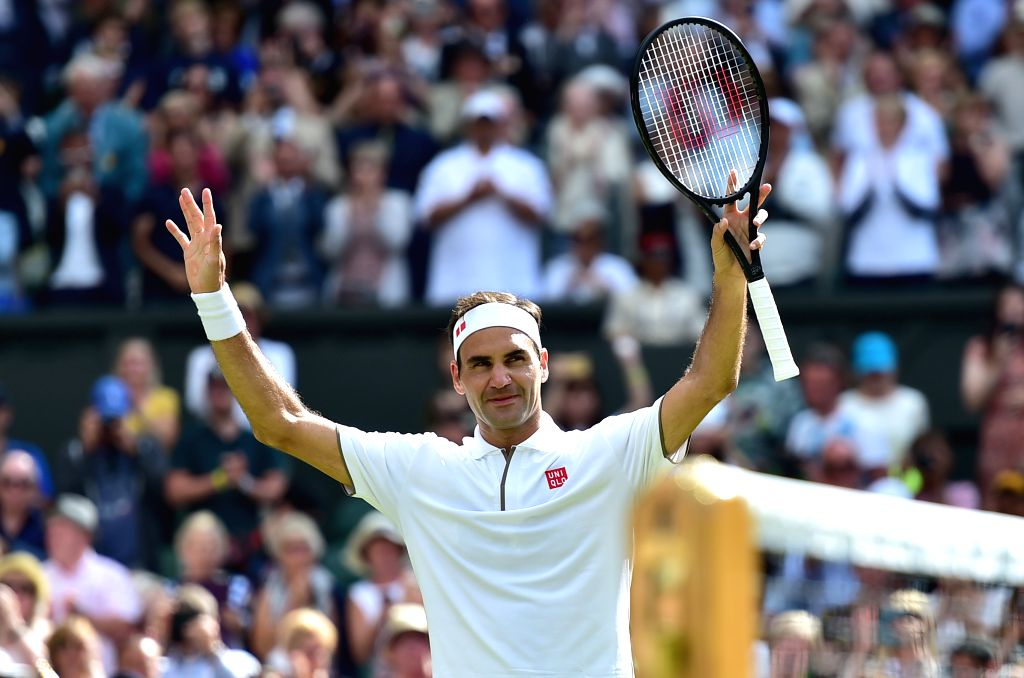 LONDON, July 3, 2019 (Xinhua) -- Roger Federer of Switzerland celebrates after the men's singles first round match against Lloyd Harris of South Africa at the 2019 Wimbledon Tennis Championships in London, Britain, July 2, 2019. (Xinhua/Lu Yang/IANS)