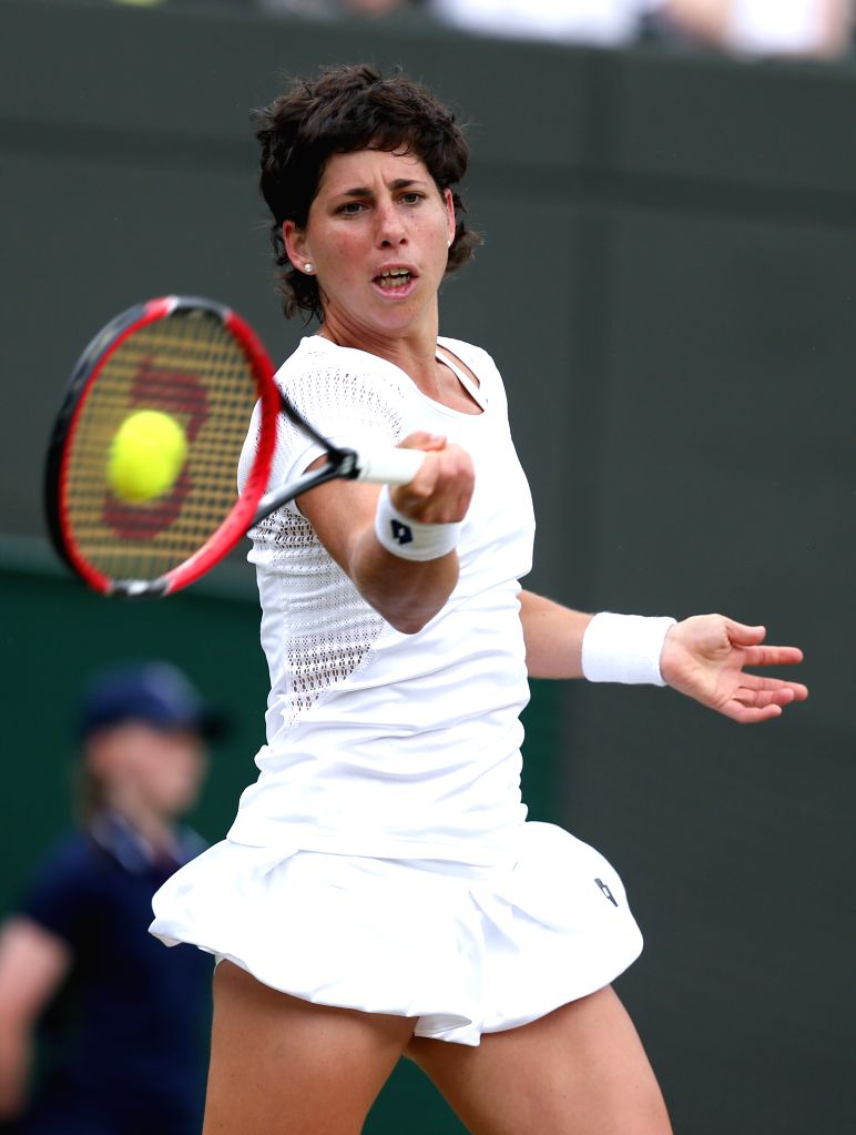 LONDON, July 4, 2016 - Carla Suarez Navarro of Spain hits a return to Venus Williams of the United States during their women's singles fourth round match at the Wimbledon Tennis Championships in ...