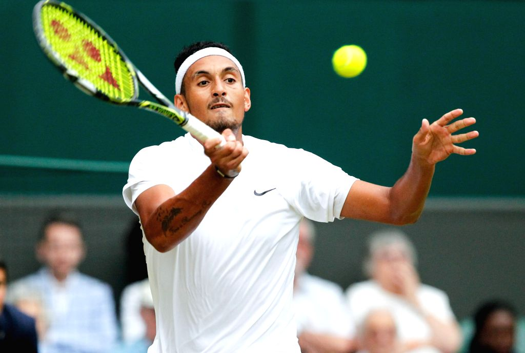 LONDON, July 4, 2016 - Nick Kyrgios of Australia hits a return to Andy Murray of Britain during their men's singles fourth round match at the Wimbledon Tennis Championships in London, Britain on July ...