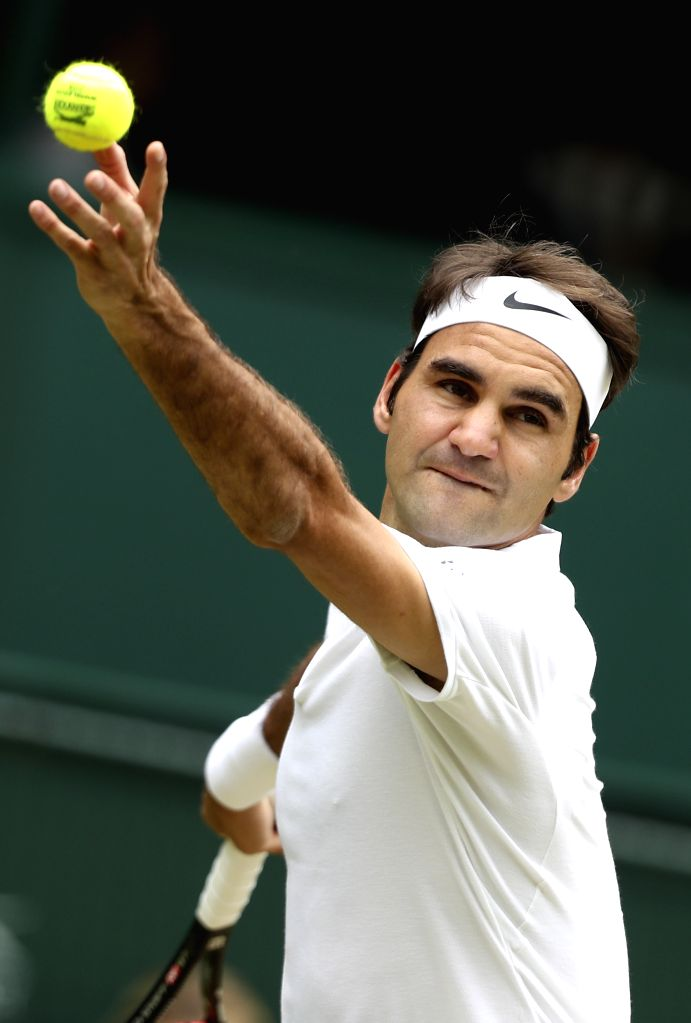 LONDON, July 4, 2016 - Roger Federer of Switzerland serves the ball during the men's singles fourth round match against Steve Johnson of the United States at the 2016 Wimbledon Championships in ...