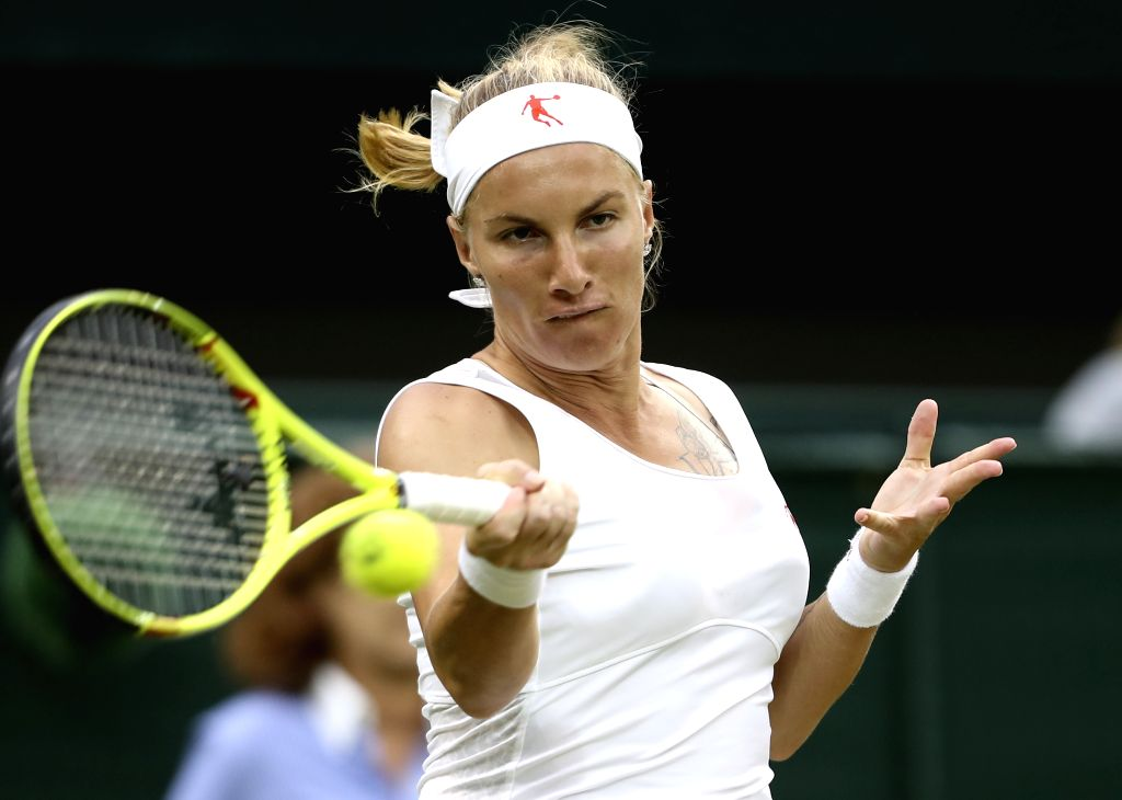 LONDON, July 4, 2016 - Svetlana Kuznetsova of Russia hits a return to Serena Williams of the United States during their women's singles fourth round match at the Wimbledon Tennis Championships in ...