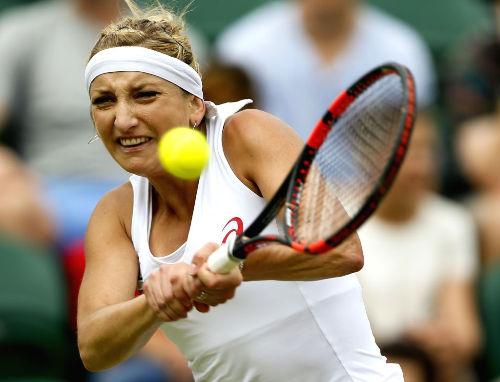 LONDON, July 4, 2016 - Timea Bacsinszky of Switzerland  returns the ball during the women's singles third round match against Anastasia Pavlyuchenkova of Russia at the 2016 Wimbledon Tennis ...