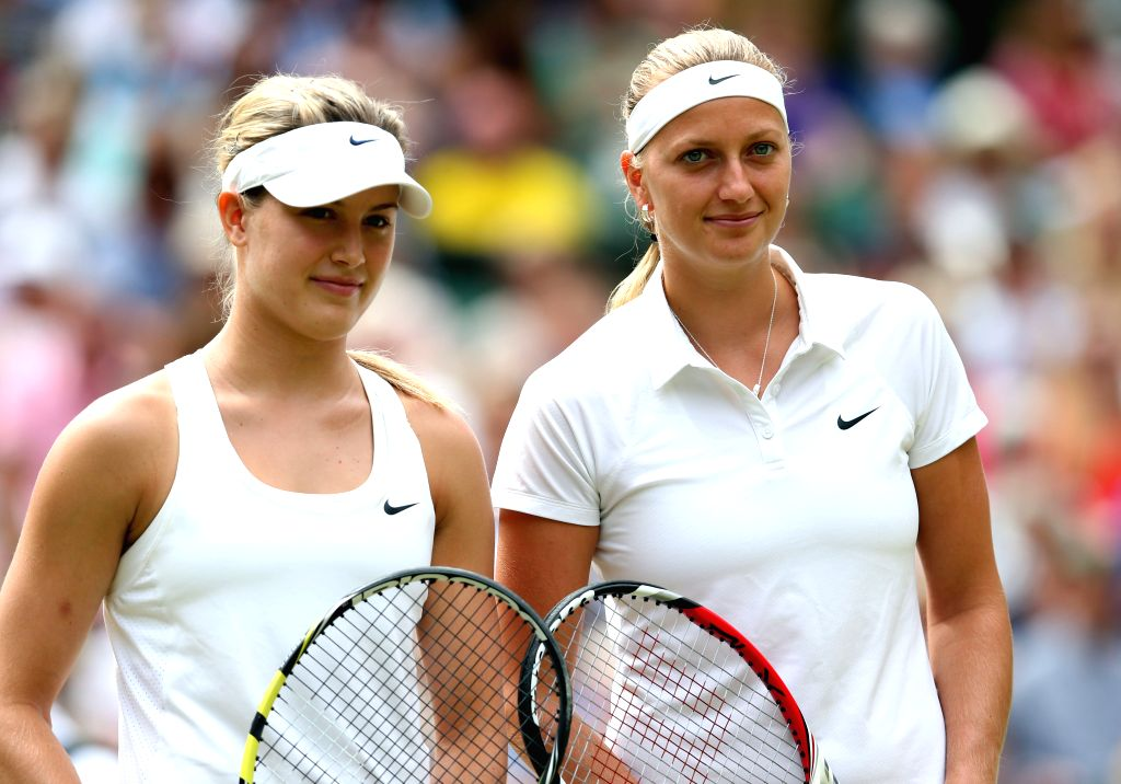 Czech Republic's Petra Kvitova (R) poses with Canada's Eugenie Bouchard before the women's singles final match against at the 2014 Wimbledon Championships in ...