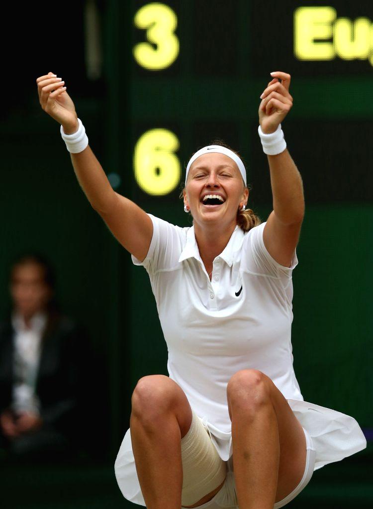 Czech Republic's Petra Kvitova celebrates after the women's singles final match against Canada's Eugenie Bouchard at the 2014 Wimbledon Championships in Wimbledon, ...
