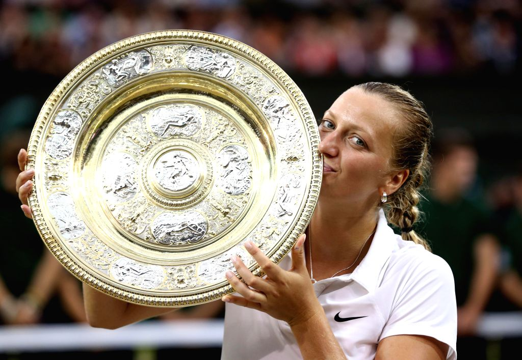 Czech Republic's Petra Kvitova poses with the trophy during the award ceremony after the women's singles final match against Canada's Eugenie Bouchard at the 2014 ...