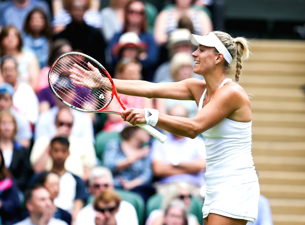 LONDON, July 5, 2016 - Angelique Kerber of Germany gestures during the women's singles quarterfinal match against Simona Halep of Romania at the Wimbledon Tennis Championships in London, Britain, on ...