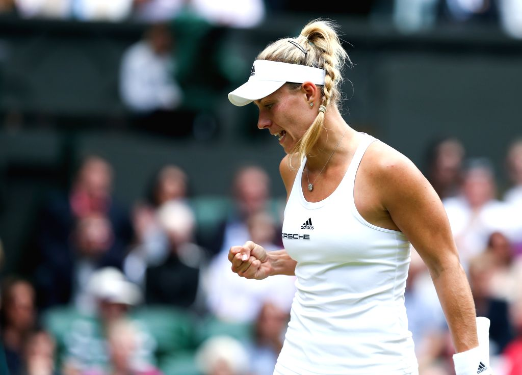 LONDON, July 5, 2016 - Angelique Kerber of Germany jubilates during the women's singles quarterfinal match against Simona Halep of Romania at the Wimbledon Tennis Championships in London, Britain, on ...
