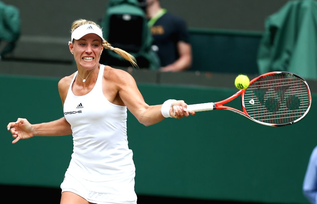 LONDON, July 5, 2016 - Angelique Kerber of Germany returns a shot during the women's singles quarterfinal match against Simona Halep of Romania at the Wimbledon Tennis Championships in London, ...