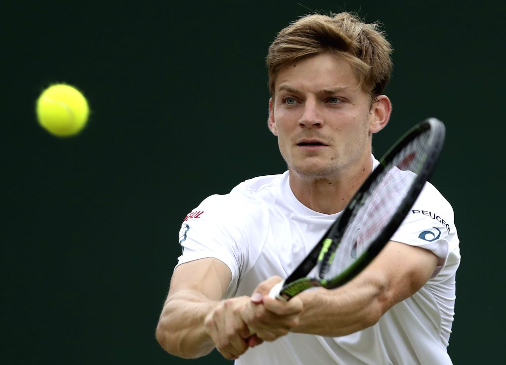 LONDON, July 5, 2016 - David Goffin of Belgium hits a return to Milos Raonic of Canada during their men's singles fourth round match at the Wimbledon Tennis Championships in London, Britain on July ...