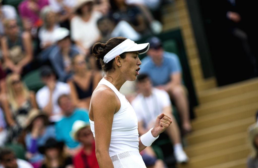 LONDON, July 5, 2017 - Garbine Muguruza of Spain celebrates after scoring during the women's singles first round match against Ekaterina Alexandrova of Russia at the Championship Wimbledon 2017 in ...