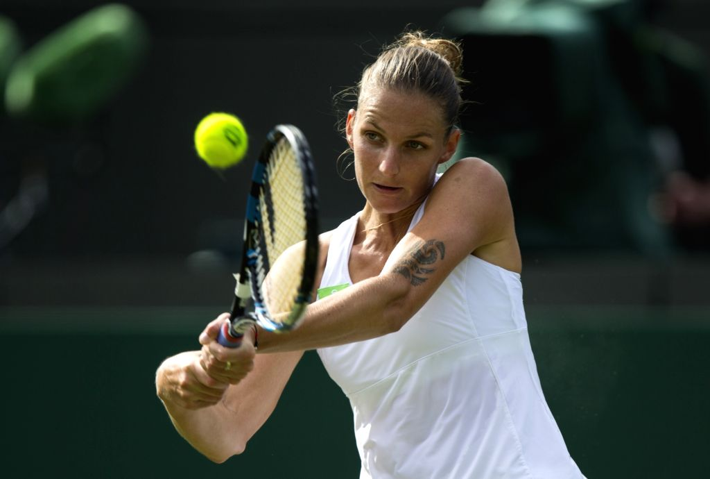 LONDON, July 5, 2017 - Karolina Pliskova of the Czech Republic hits a return during the women's singles first round match against Evgeniya Rodina of Russia at the Championship Wimbledon 2017 in ...
