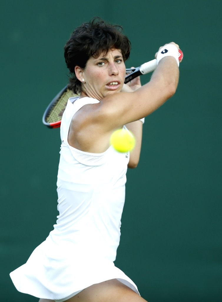 LONDON, July 6, 2017 - Carla Suarez Navarro of Spain hits a return during the women's singles second round match against Peng Shuai of China at the Championship Wimbledon 2017 in London, Britain, on ...