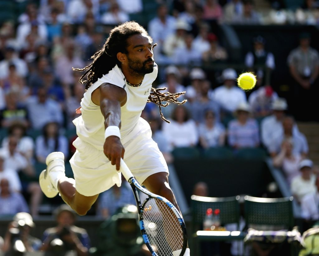 LONDON, July 6, 2017 - Dustin Brown of Germany hits a return during the men's singles second round match against Andy Murray of Britain at the Championship Wimbledon 2017 in London, Britain, on July ...