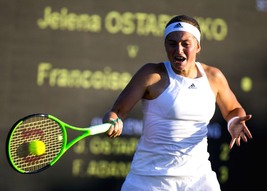 LONDON, July 6, 2017 - Jelena Ostapenko of Latvia hits a return during the women's singles second round match against Francoise Abanda of Canada at the Championship Wimbledon 2017 in London, Britain, ...
