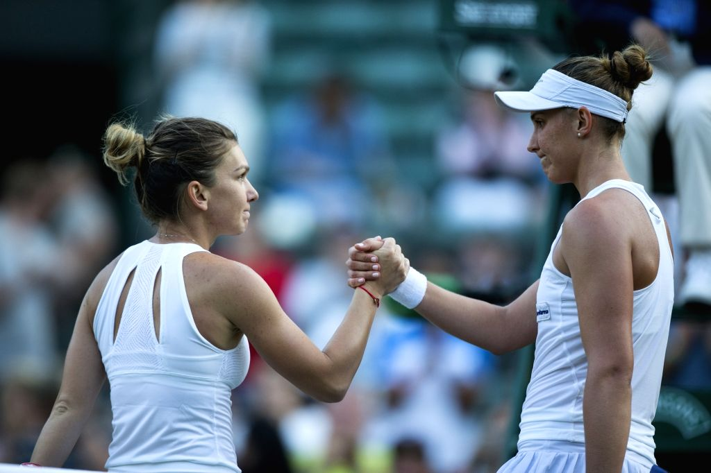 LONDON, July 6, 2017 - Simona Halep of Romania (L) shakes hands with Beatriz Haddad Maia of Brazil after their women's singles second round match at the Championship Wimbledon 2017 in London, ...