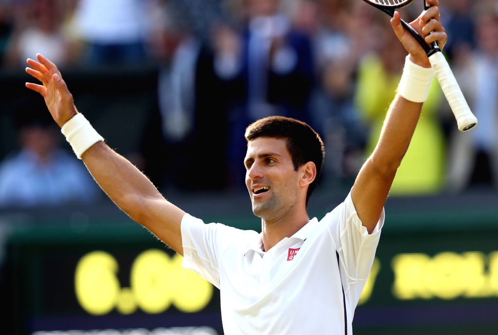Serbia's Novak Djokovic celebrates after winning the men's singles final against Switzerland's Roger Federer at the 2014 Wimbledon Championships in Wimbledon, ...