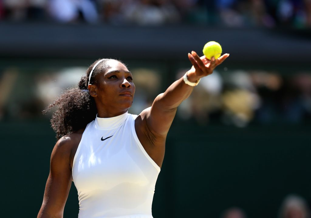 LONDON, July 7, 2016 - Serena Williams of the United States serves during the women's singles semifinal with Elena Vesnina of Russia on Day 10 at The Championships Wimbledon 2016 in London, Britain ...