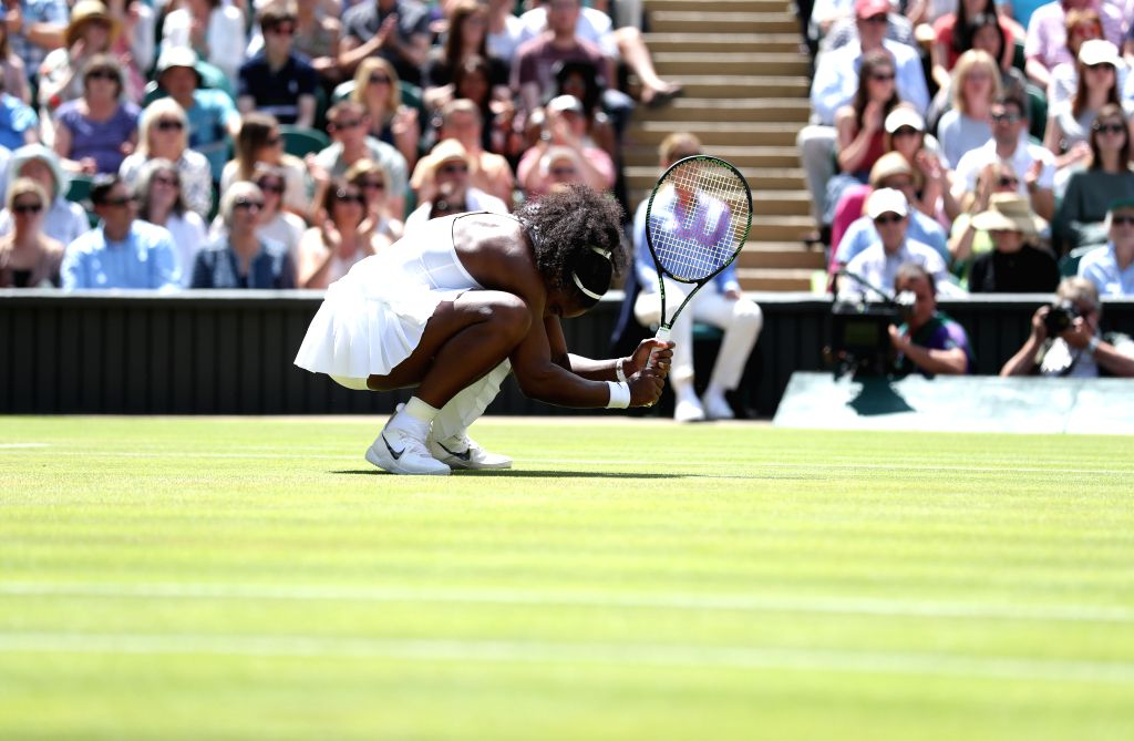 LONDON, July 7, 2016 - Serena Williams of the United States crouches down during the women's singles semifinal with Elena Vesnina of Russia on Day 10 at the Championships Wimbledon 2016 in London, ...