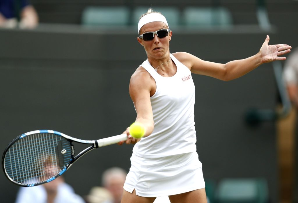 LONDON, July 7, 2017 - Kirstern Flipkens of Belgium hits a return during the women's singles second round match against Angelique Kerber of Germany at the Championship Wimbledon 2017 in London, ...