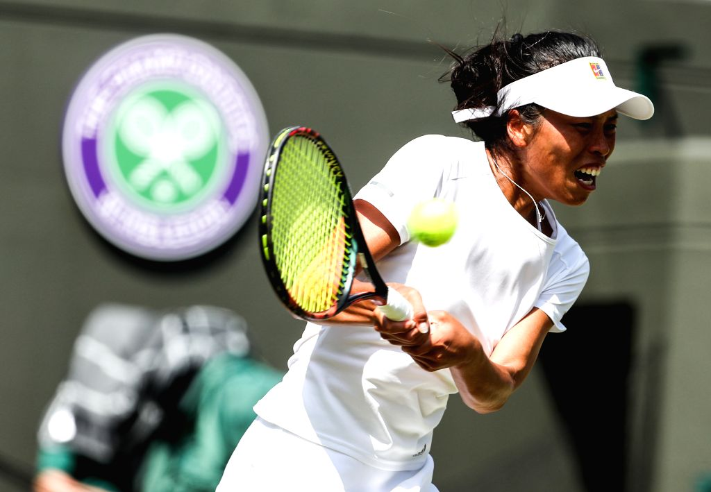 LONDON, July 7, 2018 - Hsieh Su-Wei of Chinese Taipei hits a return during the women's singles third round match against Simona Halep of Romania at the Wimbledon Championships 2018 in London, ...