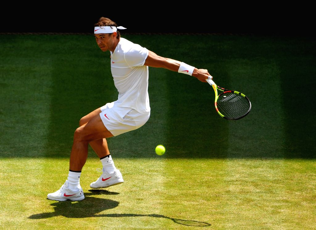 LONDON, July 7, 2018 - Rafael Nadal of Spain hits a return during the men's singles third round match against Alex De Minaur of Australia at the Wimbledon Championships 2018 in London, Britain, July ...