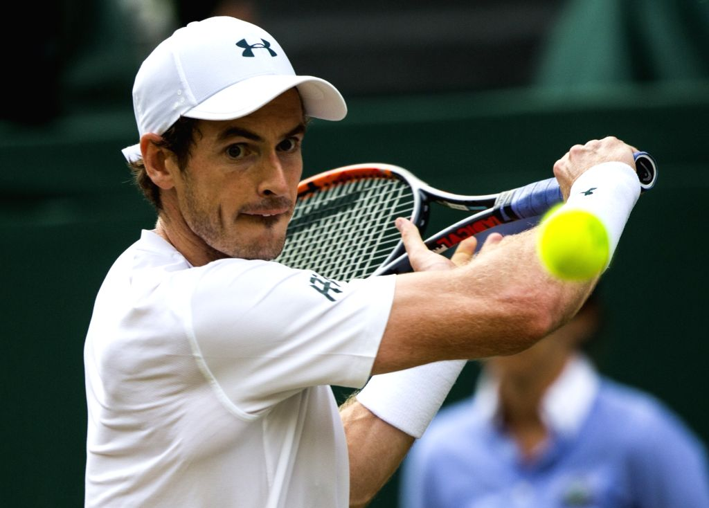 LONDON, July 8, 2017 - Andy Murray of Britain hits a return during the men's singles third round match against Fabio Fognini of Italy at the Championship Wimbledon 2017 in London, Britain, on July 7, ...