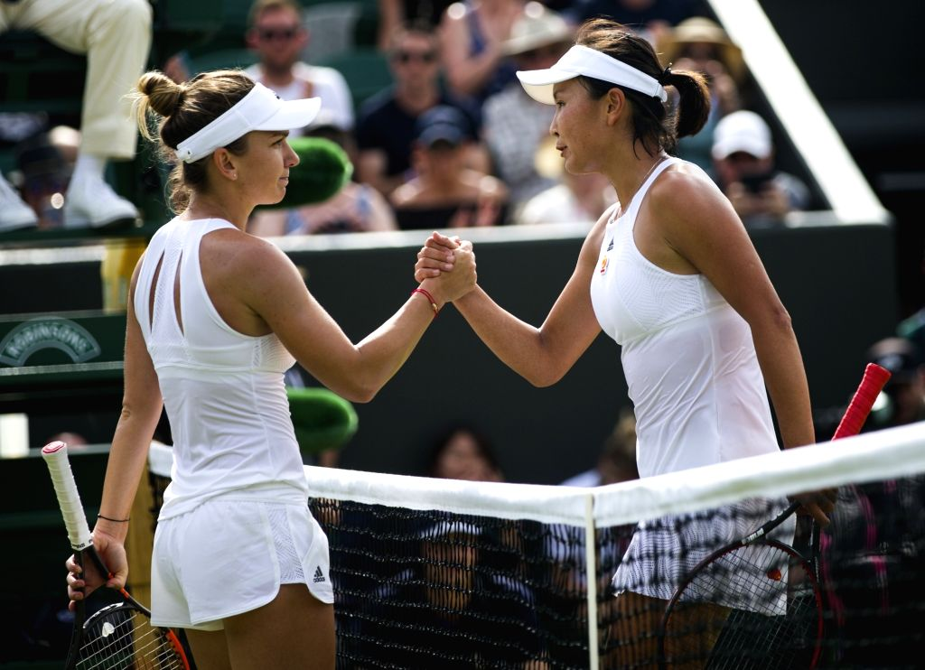 LONDON, July 8, 2017 - Simona Halep (L) of Romania and Peng Shuai of China greet each other after their women's singles third round match at the Championship Wimbledon 2017 in London, Britain, on ...